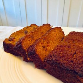 Thick slices of paleo carrot cake on a white platter.