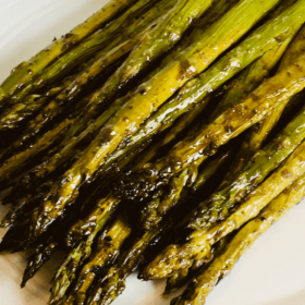 Pinterest image of asparagus on a white plate.
