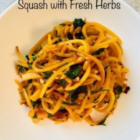 A white bowl filled with spiralized butternut squash noodles.