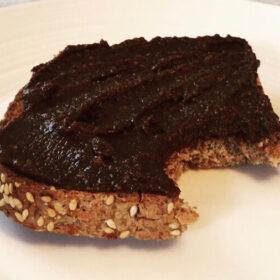 Close up of a piece of toast spread with chocolate hazelnut spread.