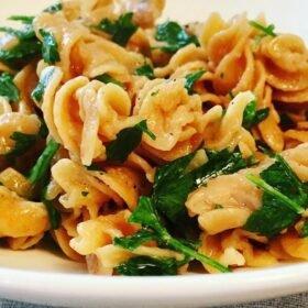 Lemon garlic pasta in a white dish.
