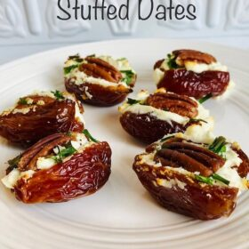 A platter of stuffed dates with white tile in the background.