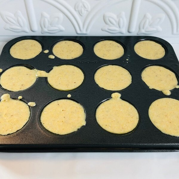 Raw batter in a muffin pan.