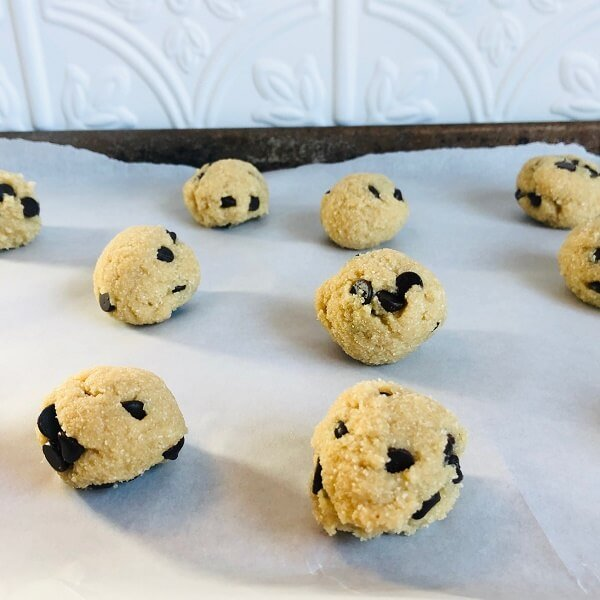 Paleo cookie dough balls on a sheet pan.