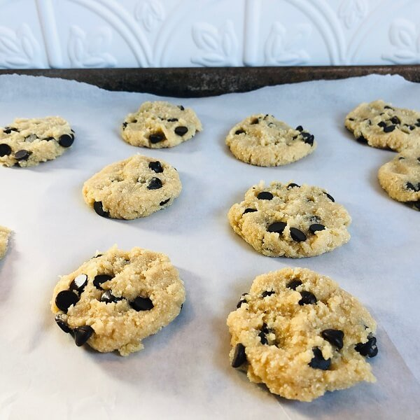 Flattened paleo raw cookie dough on a baking tray.