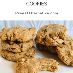 A pile of cookies against a white tile background.