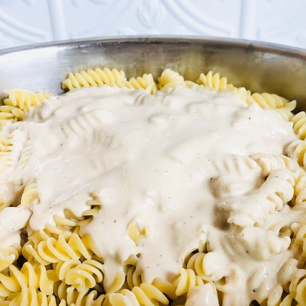 Pasta smothered in a creamy white sauce.