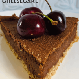 Pinterest image of a slice of cheesecake on a white plate.