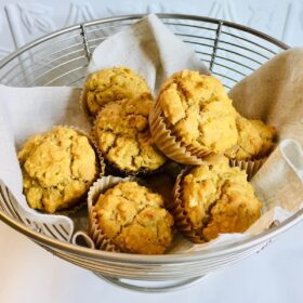 A wire basket filled with muffins.
