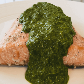 Pinterest image of green sauce on a filet of trout.