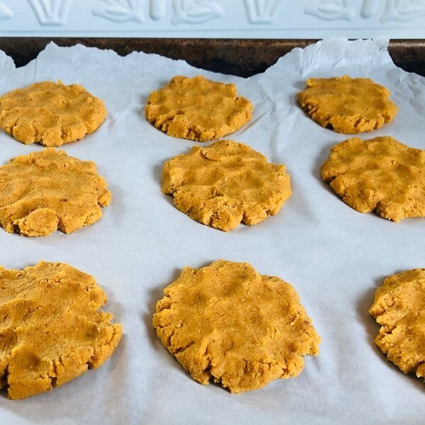 Raw cookies on parchment paper on a sheet pan.