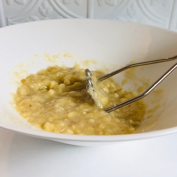 Mashed bananas in a bowl.