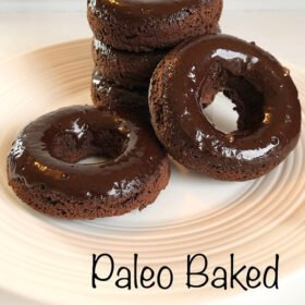 Chocolate glazed donuts displayed on a white plate.
