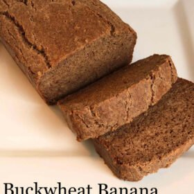 A loaf of banana bread with two slices cut.