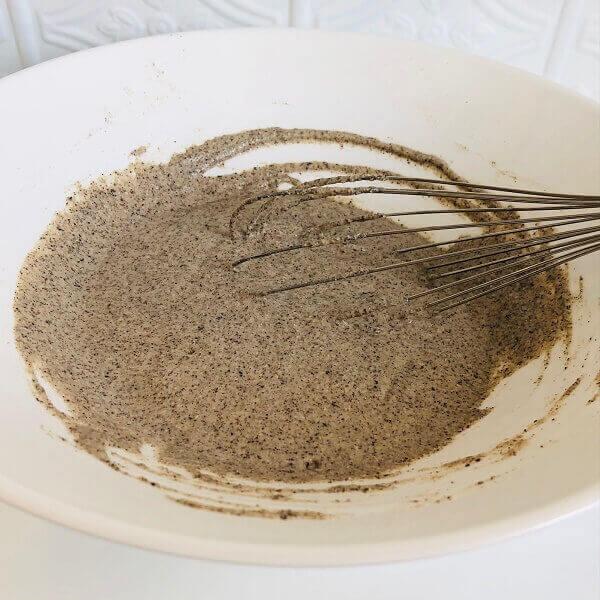 Buckwheat pancake batter in a white bowl.