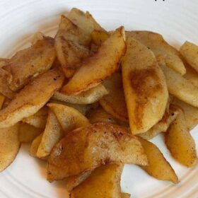 Cooked apples on a plate.