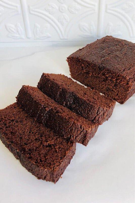 Chocolate cake on a white plate.