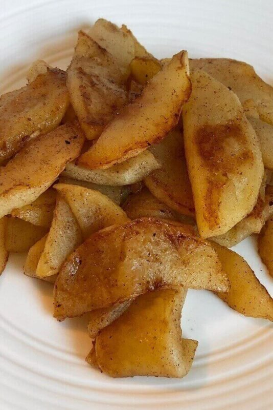 Sauteed apples on a plate.