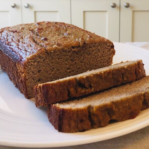 Banana bread loaf on a plate.