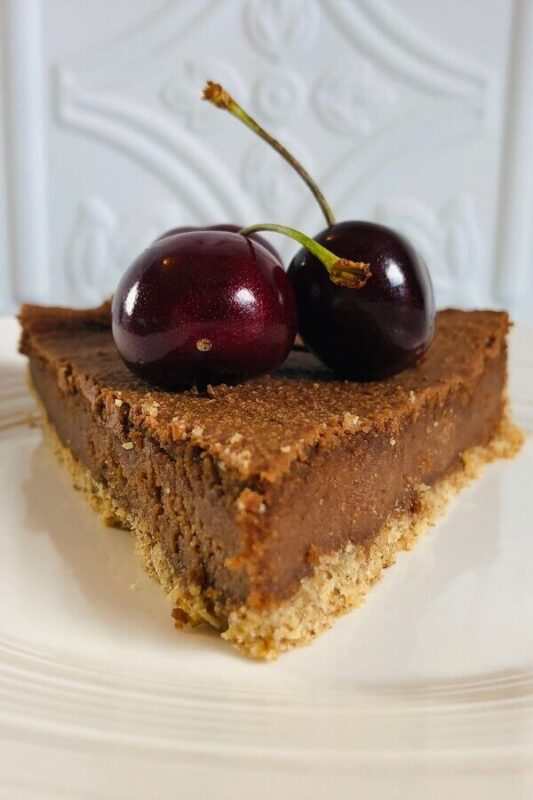 A slice of cheesecake on a white plate.