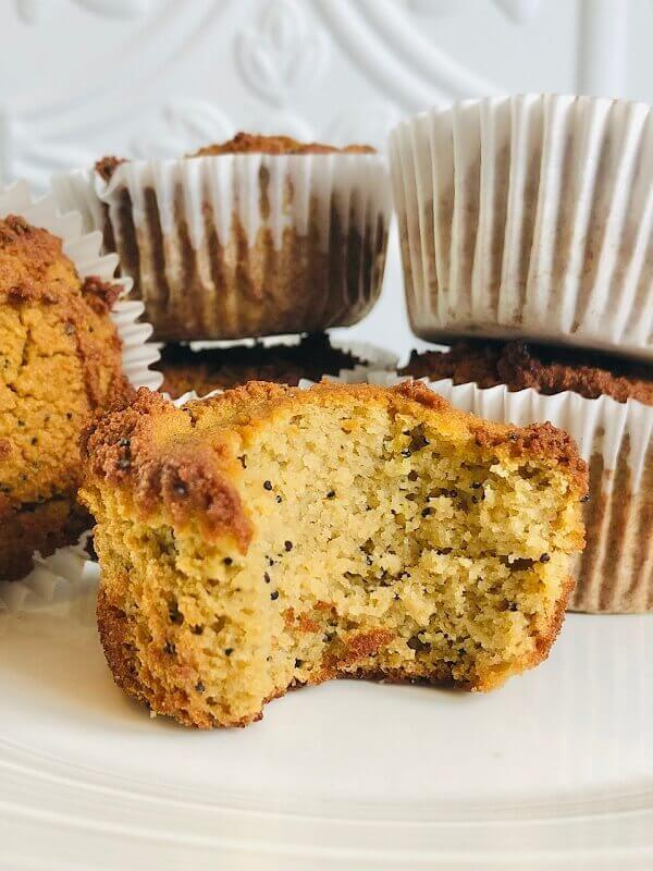 Lemon muffins displayed on a plate.