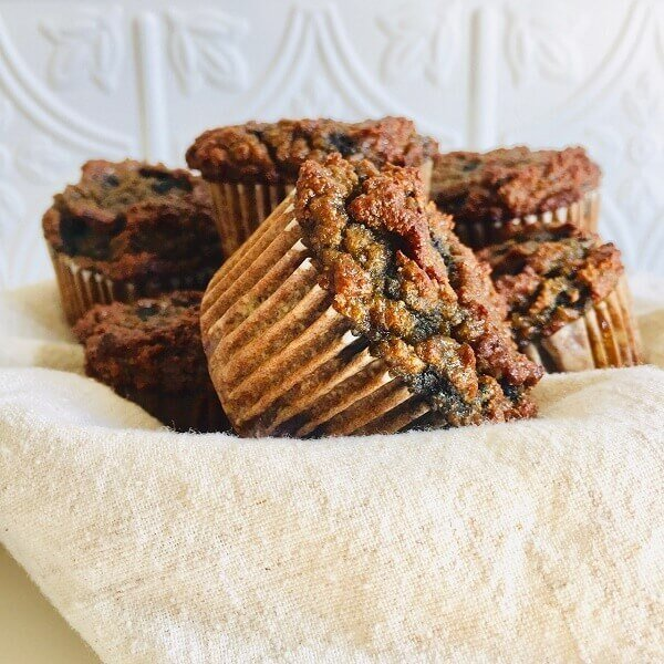 Muffins displayed in a basket.