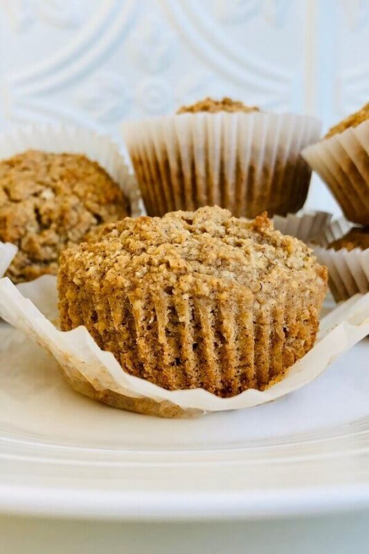Oat muffins arranged on a white plate.