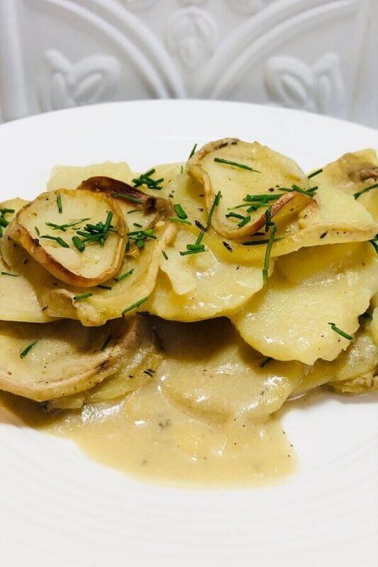 Scalloped potatoes on a plate.