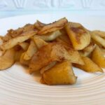 Sauteed apples on a white plate.