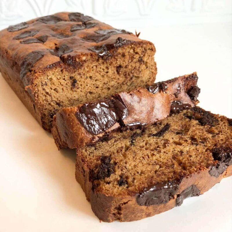 Banana bread with two slices cut off.