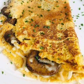 A vegan omelette with chives sprinkled on top.
