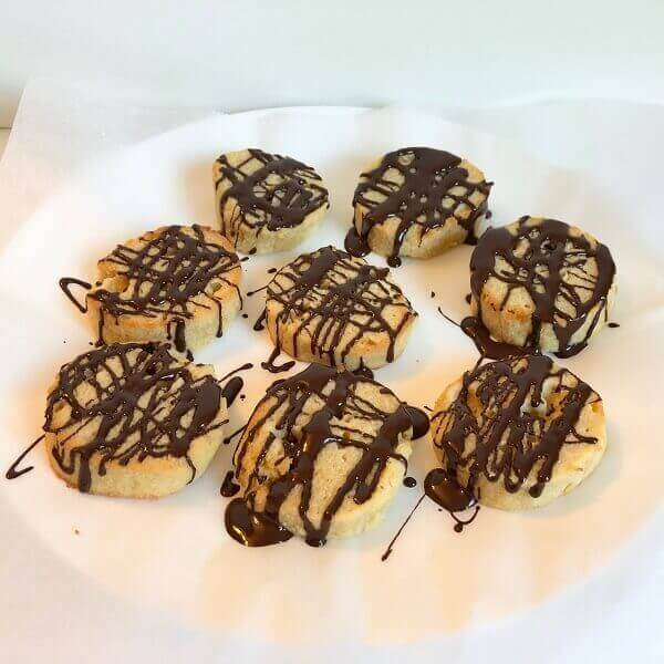 Cookies drizzled with chocolate on top.