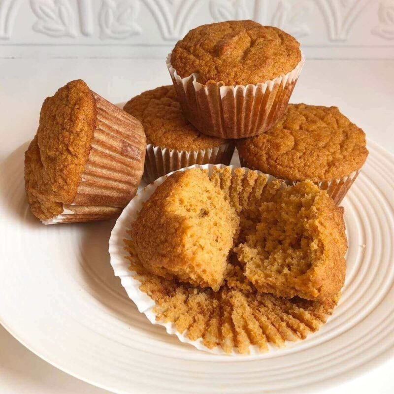 Corn flour muffins displayed on a white plate.