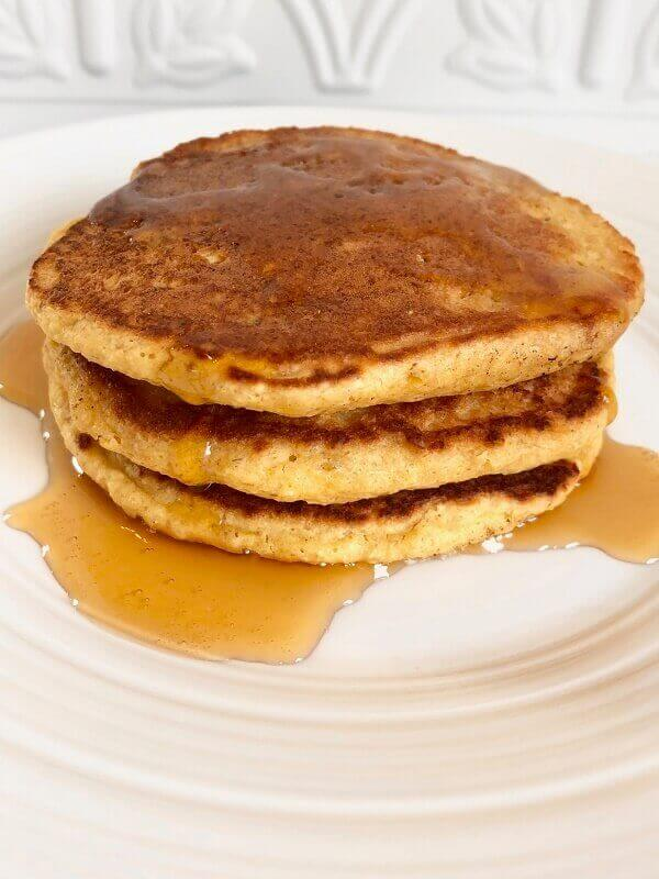 Three pancakes on a plate.