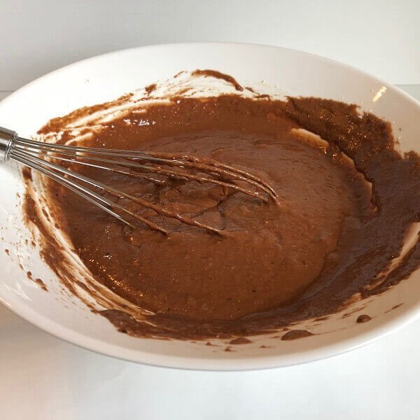 A large mixing bowl filled with raw cake batter.