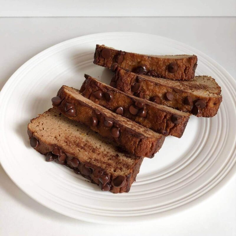 Slices of loaf cake on a white plate.