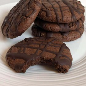 Cookies with chocolate drizzled on top.
