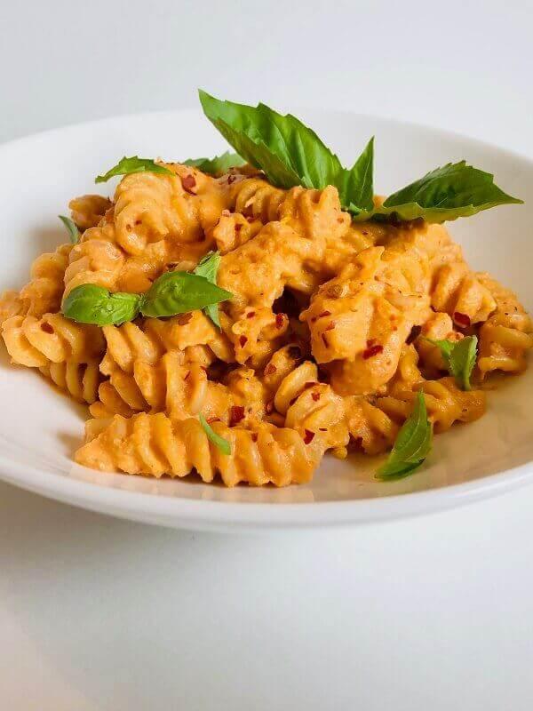 Creamy tomato pasta in a bowl.