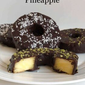 Chocolate pineapple rings displayed on a white plate.