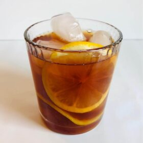 Sweet tea in a glass with lemon and ice.