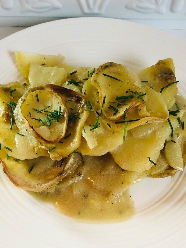Vegan scalloped potatoes on a plate.