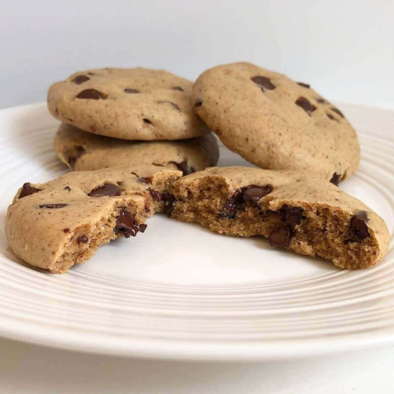 Four cookies on a white plate.