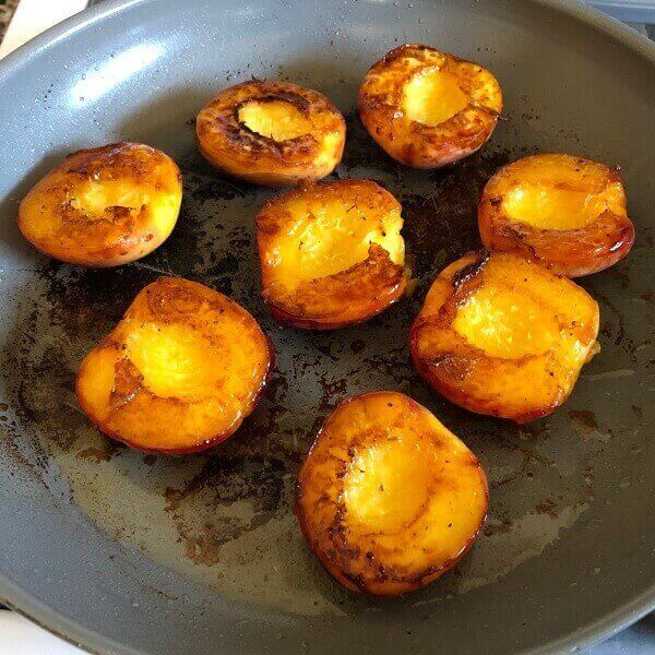 Peaches in a frying pan.