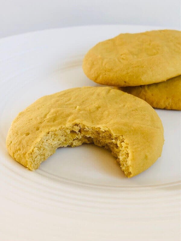 Yellow cookies on a plate.
