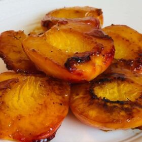 Cooked peaches piled on a plate.