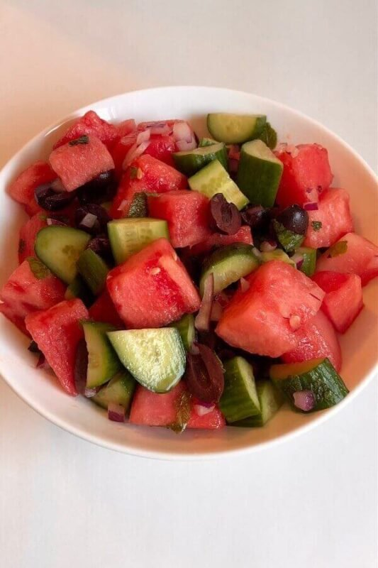 Chopped fruit salad in a bowl.