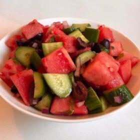 Fruit salad in a ceramic bowl.
