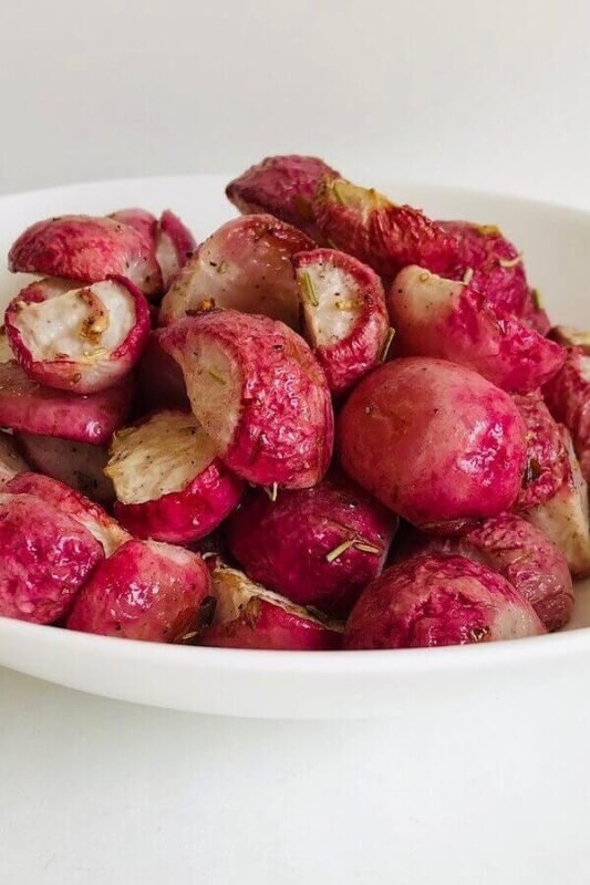 Baked radishes in a white bowl.