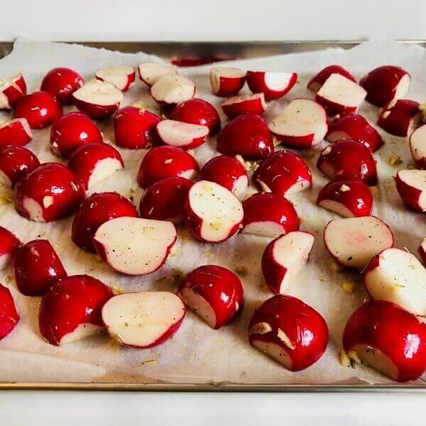 Raw radishes on a sheet pan.
